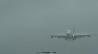 plane landing in fog